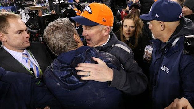 Denver Broncos head coach John Fox hugs Seattle Seahawks head coach Pete Carroll after Super Bowl XLVIII (Reuters)