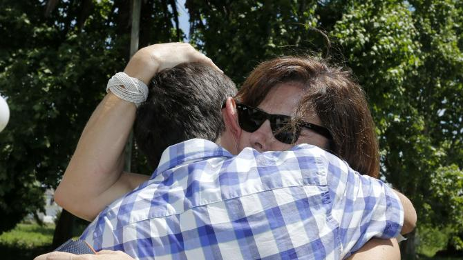 Patricia Perez Catan is embraced by her brother Fernando as they visit the former notorious clandestine detention centre known as La Cacha, in La Plata