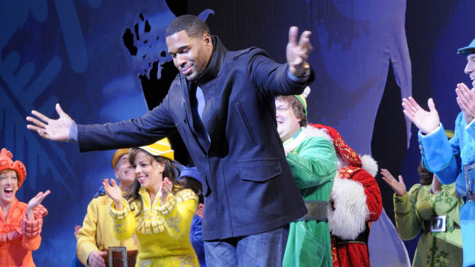 "This image released by ABC shows former NFL player Michael Strahan, center, bowing during a curtain call for the matinee show of the musical ""Elf,"" Wednesday, Dec. 5, 2012 in New York. Strahan, a co-host on the morning show ""Live! with Kelly and Michael,"" made his Broadway debut Wednesday playing three roles in the Christmas-themed musical.  (AP Photo/Disney-ABC, Lorenzo Bevilaqua)"