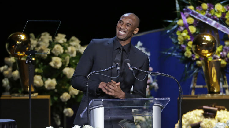 Los Angeles Lakers player Kobe Bryant speaks during a memorial service Thursday, Feb. 21, 2013, in Los Angeles for team owner Jerry Buss, who died Monday. (AP Photo/Reed Saxon)