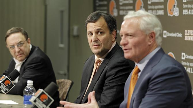 Mike Lombardi, center, the Cleveland Browns' vice president of player personnel, listens as owner Jimmy Haslam, right, speaks during a press conference at the NFL football team's practice facility in Berea, Ohio, Friday, Jan. 18, 2013. Browns' CEO Joe Bannler looks on, left. (AP Photo/Mark Duncan)