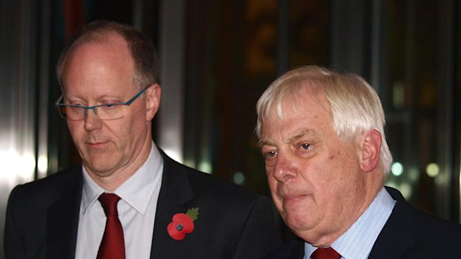 """The BBC Director General, George Entwistle, left, stands with the Chairman of the BBC Trust, Lord Chris Patten, as he announces his resignation as Director General outside New Broadcasting House in central London, after recent news program problems, Saturday Nov. 10, 2012. The BBC's director general had said earlier Saturday that it should not have aired a report that wrongly implicated a politician in a child sex-abuse scandal, admitting that the program further damaged trust in a broadcaster already reeling from the fallout over its decision not to air similar allegations against one of its star hosts. George Entwistle's comments followed an embarrassing retreat for the BBC, which apologized Friday for its Nov. 2 """"Newsnight"""" TV show on alleged sex abuse in Wales in the 1970s and 1980s. During the program, victim Steve Messham claimed he had been abused by a senior Conservative Party figure. The BBC didn't name the alleged abuser, but online rumors focused on Alistair McAlpine, a Conservative Party member of the House of Lords. On Friday, he issued a fierce denial and threatened to sue.  (AP Photo/ Max Nash)"""