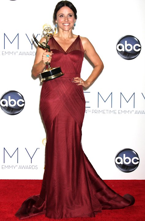 Emmys 2012: Veep's Julia Louis-Dreyfus showed off her figure in a slinky deep red gown.