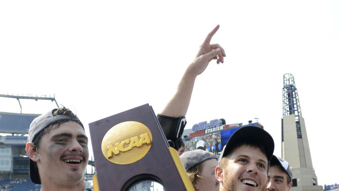 Loyola lacrosse players  Scott Ratliff, left, and Eric Lusby, right, celebrate their 9-3 victory over Maryland in the  Division I NCAA men's lacrosse championship game at Gillette Stadium in Foxborough, Mass., Monday, May 28, 2012. (AP Photo/Gretchen Ertl)