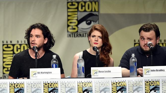 """(L-R) Actors Kit Harington, Rose Leslie and John Bradley at the """"Game Of Thrones"""" panel during Comic-Con International in San Diego on July 25, 2014"""