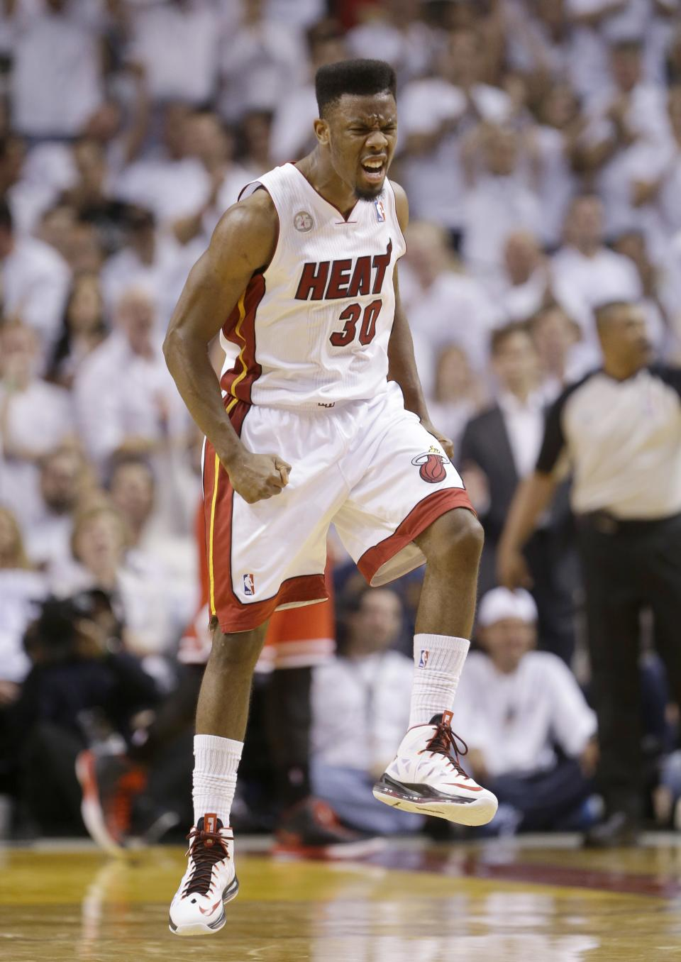 Miami Heat guard Norris Cole celebrates after dunking to put the Heat ahead of the Chicago Bulls during the second half of Game 5 of an NBA basketball playoffs Eastern Conference semifinal, Wednesday, May 15, 2013, in Miami. The Heat defeated the Bulls 94-91 and advance to the conference finals. (AP Photo/Wilfredo Lee)