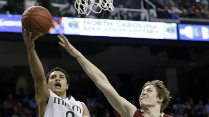 Miami's Shane Larkin, left, drives past Boston College's Patrick Heckmann, right, and Ryan Anderson, front, during the second half of an NCAA college basketball game at the Atlantic Coast Conference tournament in Greensboro, N.C., Friday, March 15, 2013. (AP Photo/Gerry Broome)