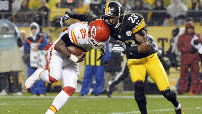 Kansas City Chiefs running back Jamaal Charles (25) is hit by Pittsburgh Steelers cornerback Keenan Lewis (23) during the first quarter of an NFL football game, Monday, Nov. 12, 2012, in Pittsburgh. (AP Photo/Don Wright)