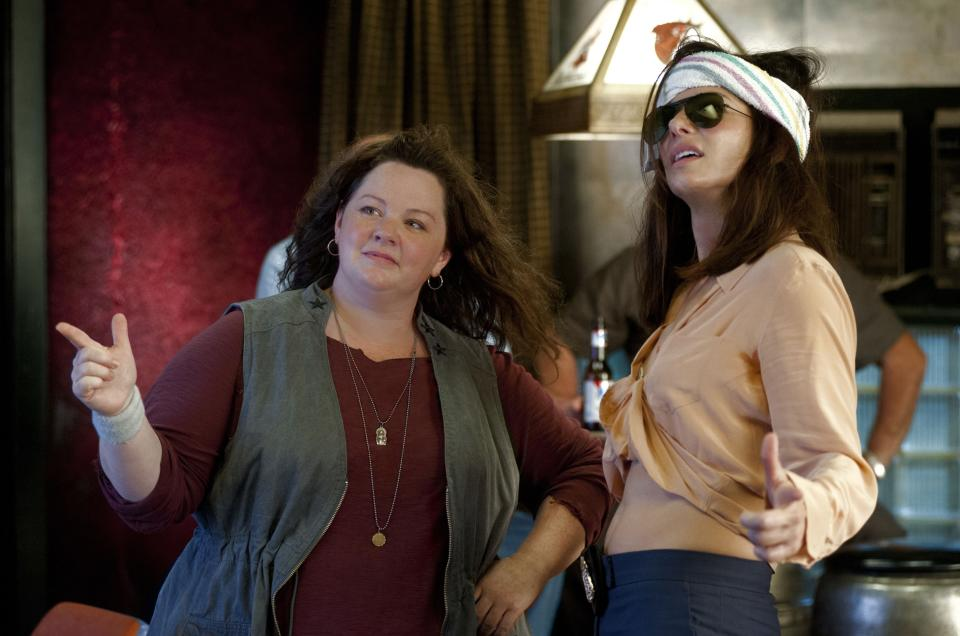 "This film publicity image released by 20th Century Fox shows Sandra Bullock as FBI Special Agent Sarah Ashburn, right, and Melissa McCarthy as Boston Detective Shannon Mullins in a scene from ""The Heat."" (AP Photo/20th Century Fox, Gemma La Mana)"