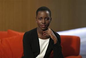 "Actress Lupita Nyong'o, who stars in the movie ""12 Years a Slave,"" poses for a portrait in Los Angeles, California November 13, 2013. REUTERS/Mario Anzuoni/Files"