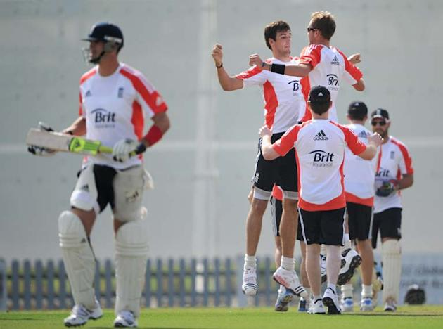 DUBAI, UNITED ARAB EMIRATES - JANUARY 06:  Steven Finn and Stuart Broad of England celebrate the wicket Kevin Pietersen during a nets session at The ICC Global Academy on January 6, 2012 in Dubai, Uni