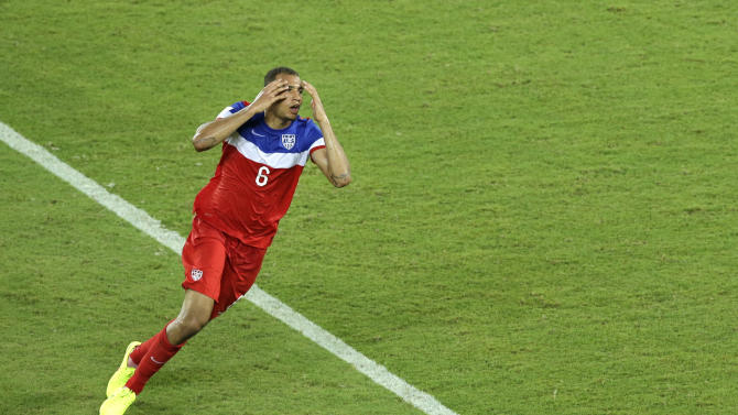 United States' John Brooks celebrates scoring his side's second goal during the group G World Cup soccer match between Ghana and the United States at the Arena das Dunas in Natal, Brazil, Monday, June 16, 2014. The United States defeated Ghana 2-1. (AP Photo/Hassan Ammar)