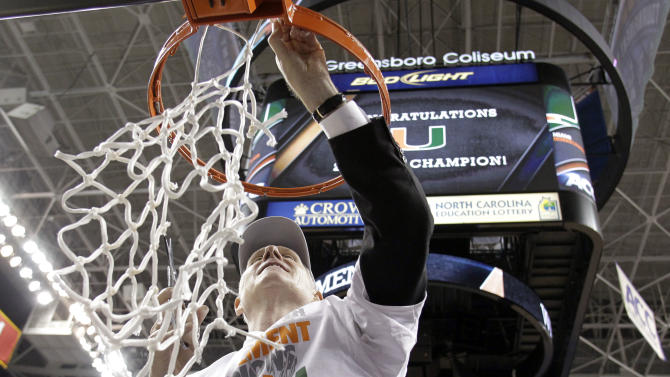 Miami head coach Jim Larranaga cuts the net after beating North Carolina in an NCAA college basketball game tyo win the Atlantic Coast Conference tournament in Greensboro, N.C., Sunday, March 17, 2013.  Miami won 87-77. (AP Photo/Bob Leverone)