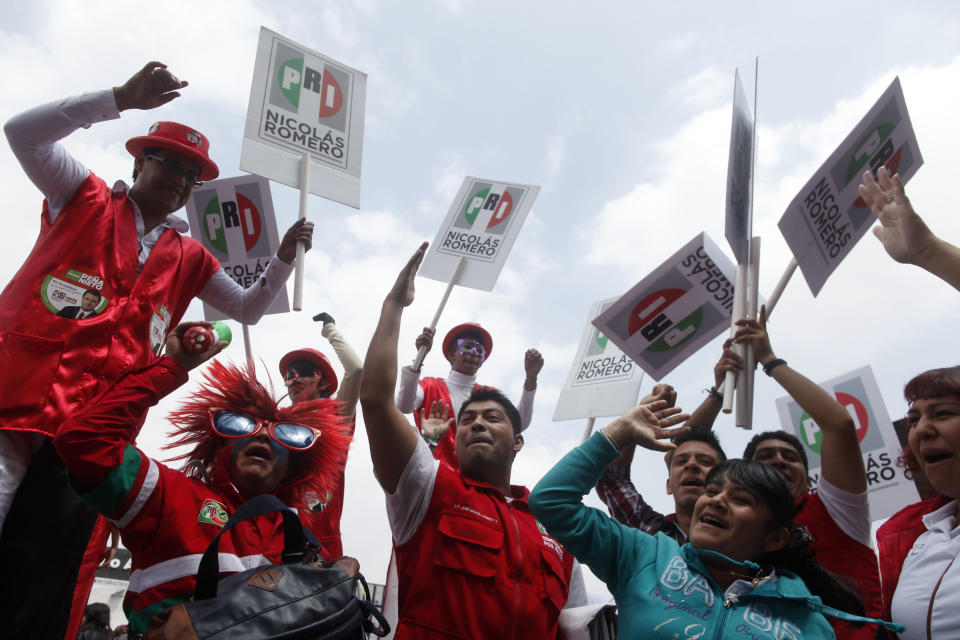 Supporters of Enrique Pena Nieto, presidential candidate of the opposition Institutional Revolutionary Party, PRI, cheer during a campaign rally at the Azteca stadium in Mexico City, Sunday, June 24, 2012. General elections in Mexico are scheduled for Sunday, July 1. (AP Photo/Esteban Felix)
