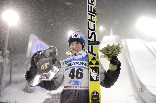 Poland's Kamil Stoch celebrates his victory in the FIS Ski Jumping World Cup Large Hill competition in Kuopio