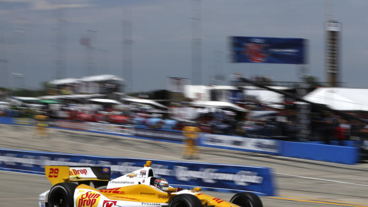 Ryan Hunter-Reay (28) drives through a turn during the Izod IndyCar Series auto race at the Milwaukee Mile in West Allis, Wis., Saturday, June, 16, 2012. (AP Photo/Jeffrey Phelps)