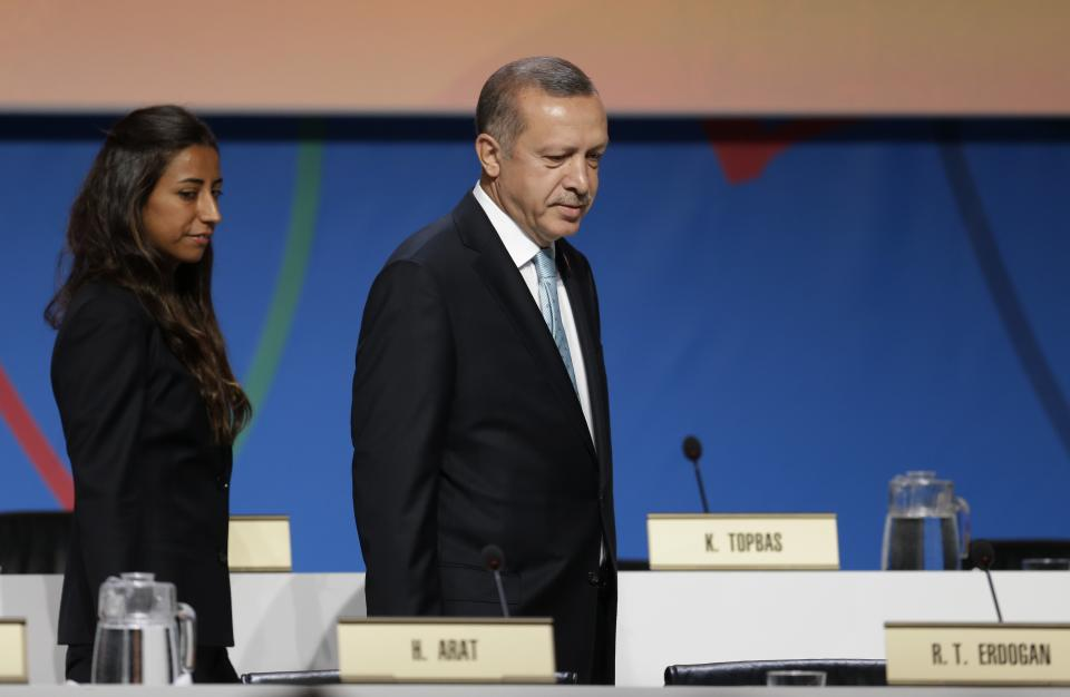 Turkey's Prime Minister Tayyip Erdogan arrives to attend the Istanbul 2020 bid presentation during the International Olympic Committee session, Saturday, Sept. 7, 2013, in Buenos Aires, Argentina. Madrid, Istanbul and Tokyo are competing to host the 2020 Summer Olympic Games. (AP Photo/Natacha Pisarenko)