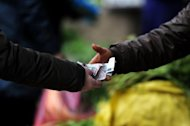 A resident buys vegetables at a market in Hefei, east China&#39;s Anhui province, March 2012. China said on Saturday it would cut reserve requirements for banks, after disappointing economic data raised fears of a sharp slowdown in the world&#39;s second largest economy