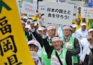 "Protesters from a Japanese local farmer's group stage a demonstration march with a placard written ""Let's protect Japanese country and food"" during an anti TPP ( Trans-Pacific Partnership) rally in Tokyo in April 2012. The United States said trade negotiations with eight Pacific partners made ""important progress"" in the latest round of talks that wrapped up in California on Tuesday"