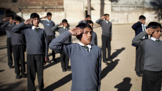 In this Thursday, Nov. 15, 2012 photo, Pakistani boys exercise a drill at the playground of the Sharosh Academy in Mingora, Swat Valley, Pakistan. The girls at Malala Yusufzai's school were quick to point out that education for both boys and girls was required under their Islamic religion. At Sharosh Academy, the principal, says both the boys and girls at his school are taught the value of education.(AP Photo/Anja Niedringhaus)