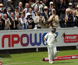 MCC members give Tendulkar a standing ovation as he walks out to bat.