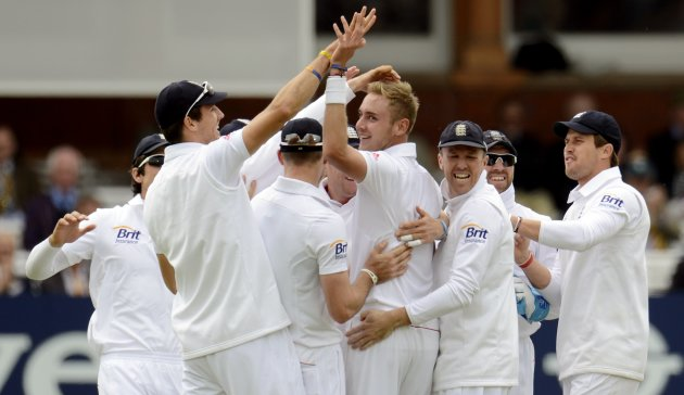 England's Broad is congratulated after dismissing New Zealand's McCullum during the first test cricket match at Lord's cricket ground in London