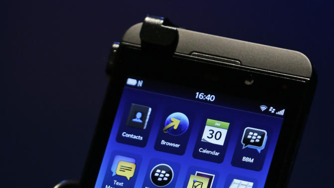 A man holds the new touchscreen BlackBerry Z10 smartphone, during a launch event for the new phone in London, Wednesday, Jan. 30, 2013. (AP Photo/Lefteris Pitarakis)