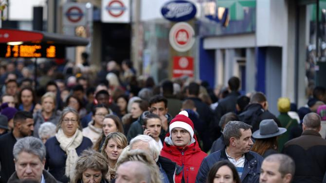 Shoppers throng Oxford street during the final weekend of shopping before Christmas in London
