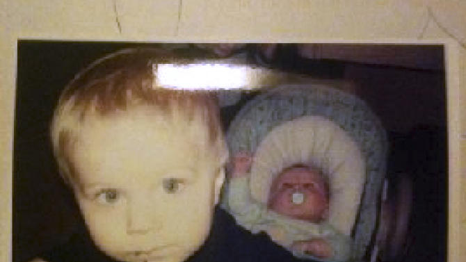 CORRECTS AGES AND LAST NAMES OF THE BOYS - This photo released by the Connecticut State Police during an Amber Alert Tuesday, Feb. 26, 2013, shows Alton Perry, 2, left, and Ashton Perry, 6 months old, right, who were taken from their daycare by their grandmother Tuesday afternoon. State police said the bodies of Ashton and Alton Perry and their grandmother, Debra Denison, 47, were found Tuesday night in Preston, Conn. Connecticut state police are calling the shooting deaths a double murder-suicide and say she had permission to pick them up from their daycare. (AP Photo/Connecticut State Police)