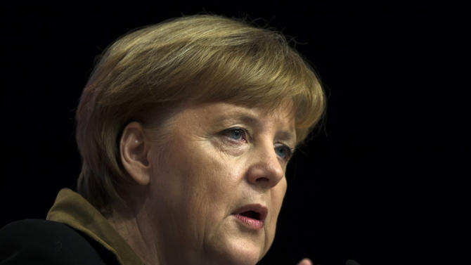 German Chancellor and chairwoman of the Christian Democratic Party, CDU, Angela Merkel delivers her keynote speech at the Party's 2012 convention in Hannover, Tuesday, Dec. 4, 2012. The ruling CDU will elect a new board and reelect Angela Merkel as the party's chairwoman at the convention. (AP Photo/Markus Schreiber)