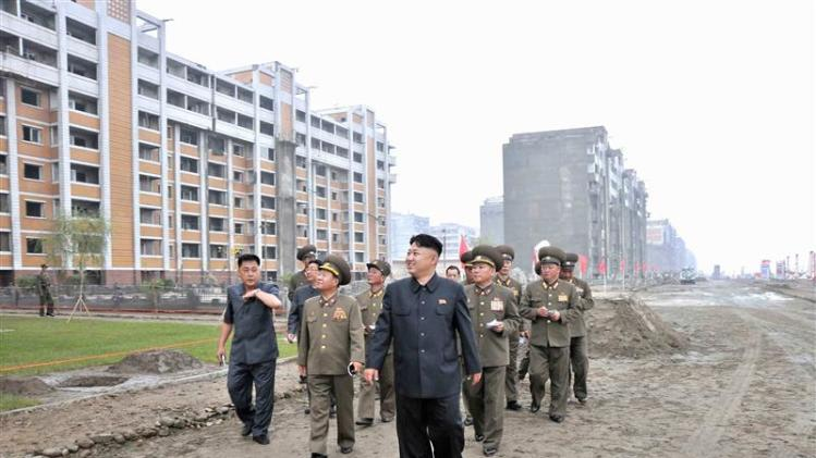 File photo shows North Korean leader Kim Jong-un inspecting the construction site of the apartment houses for scientists close to completion