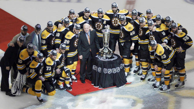NHL deputy commissioner Bill Daly, center, presents the Prince of Wales Trophy to the Eastern Conference finals champion Boston Bruins who defeated the Tampa Bay Lightning 1-0 in Game 7 of an NHL hockey Stanley Cup playoffs Eastern Conference final series, Friday, May 27, 2011, in Boston. (AP Photo/Charles Krupa)