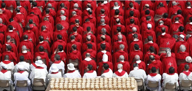 Goblets containing communion wafers are seen during a mass led by Pope Francis in Saint Peter's Square at the Vatican