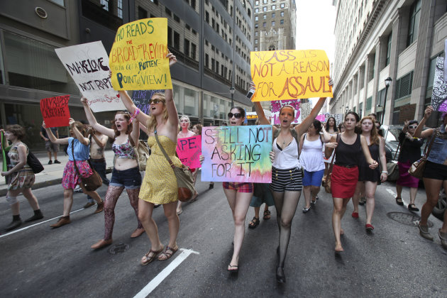People participate in the Slut Walk demonstration, in Philadelphia, on Saturday, Aug. 6, 2011. Organizers of the walk aim to raise awareness for women's issues including the fact that no woman asks to