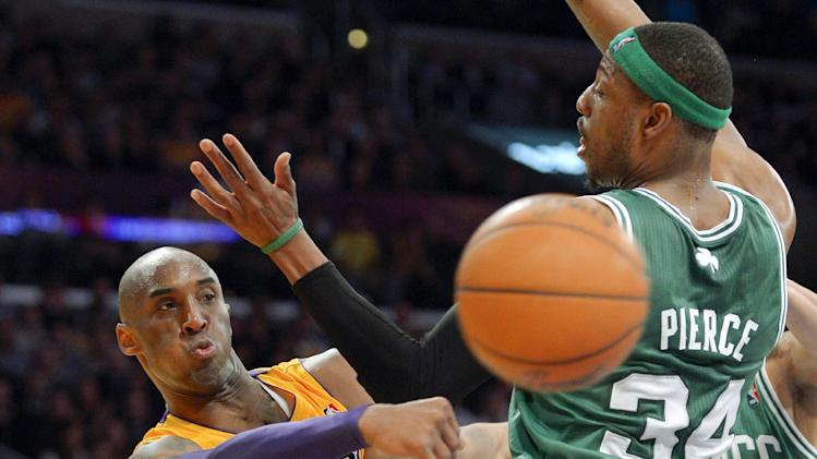 Los Angeles Lakers guard Kobe Bryant, left, passes around Boston Celtics forward Paul Pierce during the first half of their NBA basketball game, Wednesday, Feb. 20, 2013, in Los Angeles. (AP Photo/Mark J. Terrill)