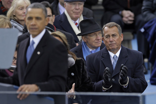 Speaker John Boehner of Ohio listen as President Barack Obama delivers his Inaugural address at the ceremonial swearing-in at the U.S. Capitol during the 57th Presidential Inauguration in Washington, Monday, Jan. 21, 2013. (AP Photo/Carolyn Kaster)
