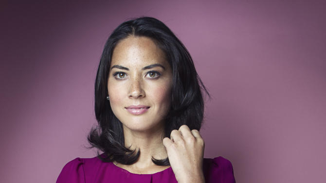 "This July 26, 2012 photo shows actress Olivia Munn posing in New York. Munn, who co-stars in the HBO series, ""The Newsroom,"" is also starring in the upcoming film ""The Babymakers."" (Photo by Victoria Will/Invision/AP)"