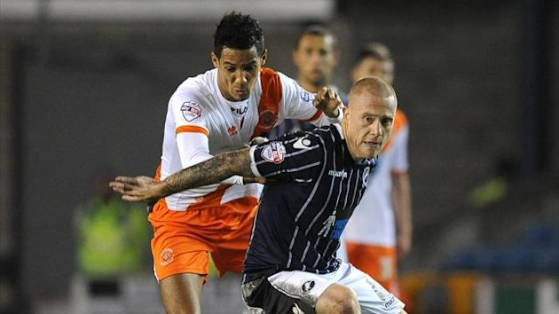 Millwall's Nicky Bailey (right) and Blackpool's Thomas Ince (left) battle for the ball (PA Sport)