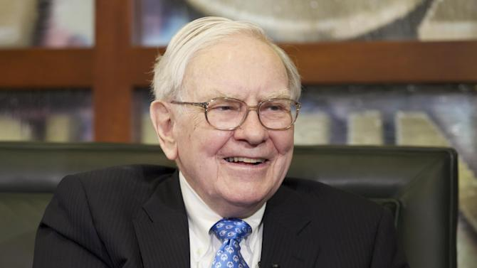FILE - In this Monday, May 6, 2013, file photo, Warren Buffett smiles during an interview with Liz Claman of the Fox Business Network in Omaha, Neb. The Berkshire Hathaway company reports quarterly earnings on Friday, Nov. 1, 2013. (AP Photo/Nati Harnik, File)