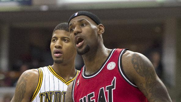 Miami Heat's LeBron James (6) reacts to a call alongside Indiana Pacers' Paul George (24) during the first half of an NBA basketball game in Indianapolis, Friday, Feb. 1, 2013. (AP Photo/Doug McSchooler)