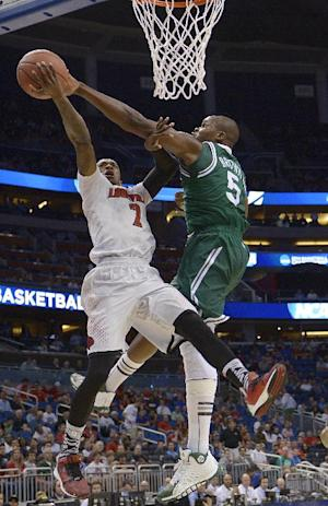 Louisville faces rival Kentucky in quest to repeat
