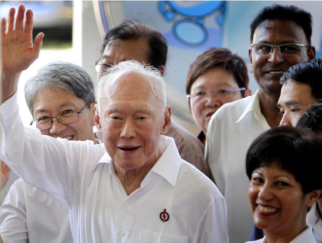 FILE - In this April 27, 2011 file photo, Singapore's Minister Mentor Lee Kuan Yew waves to supporters as he arrives at an elections nomination center in Singapore. Singapore founding father Lee Kuan