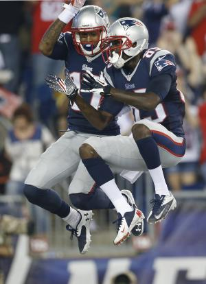 New England Patriots wide receiver Aaron Dobson (17) celebrates his touchdown against the New York Jets with wide receiver Kenbrell Thompkins, right, in the first quarter an NFL football game Thursday, Sept. 12, 2013, in Foxborough, Mass. (AP Photo/Elise Amendola)
