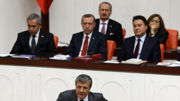 Turkish journalist and Republican People's Party MP Mustafa Balbay addresses the members of Turkish Parliament during a debate on draft budget in Ankara