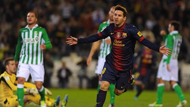 Lionel Messi celebrates beating Gerd Mueller's all-time goalscoring record of 85 in a year, in a Liga match against Real Betis on Dec. 9 2012