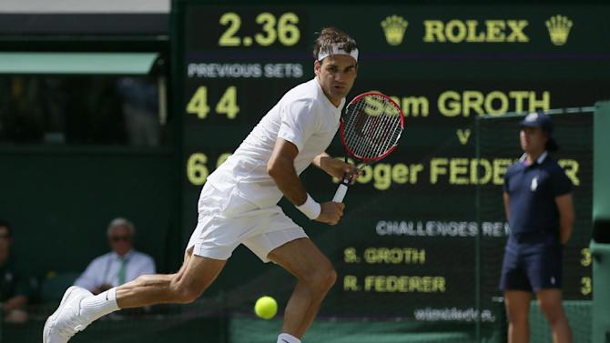 Roger Federer of Switzerland chases down a ball from Sam Groth of Australia during their singles match at the All England Lawn Tennis Championships in Wimbledon, London, Saturday July 4, 2015. (AP Photo/Tim Ireland)