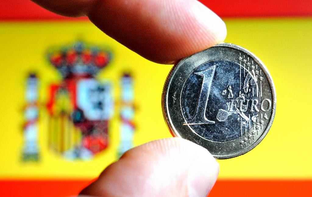 S&P raises Spain's credit rating one notch ahead of general election
