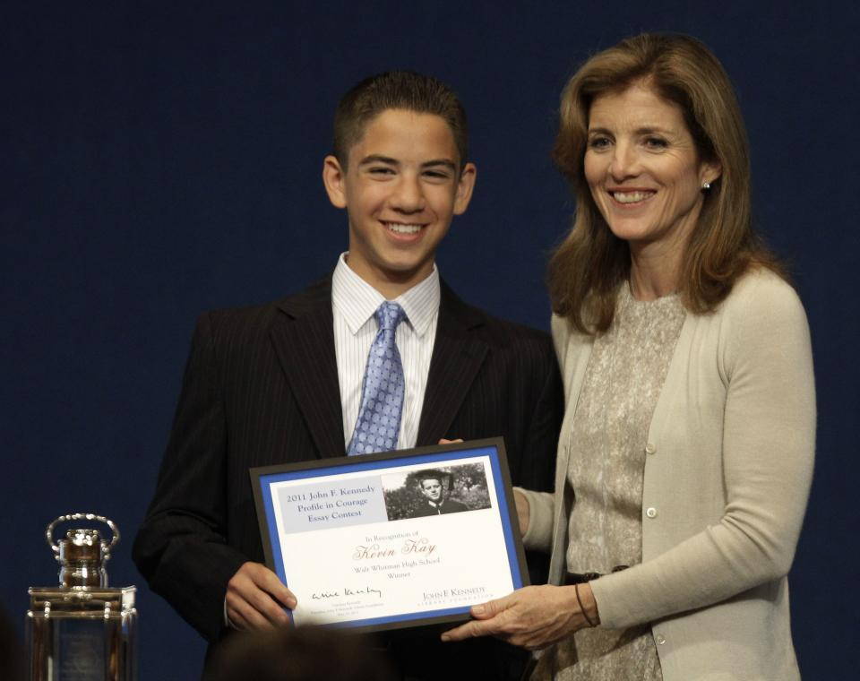 Caroline Kennedy, right, presents Kevin Kay, a junior at Walt Whitman High School in Bethesda, Md., with the  John F. Kennedy Profiles in Courage Award essay plaque for winning the contest at the JFK Library & Museum in Boston, Monday morning, May 23, 2011. (AP Photo/Stephan Savoia)