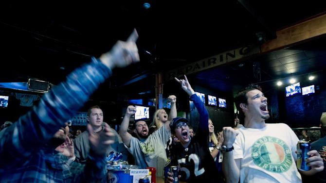 Baltimore Ravens fans celebrates after their team score the first touchdown against the San Francisco 49ers, at local pub in Baltimore Md. on Sunday Feb. 3, 2013. (AP Photo/Jose Luis Magana)