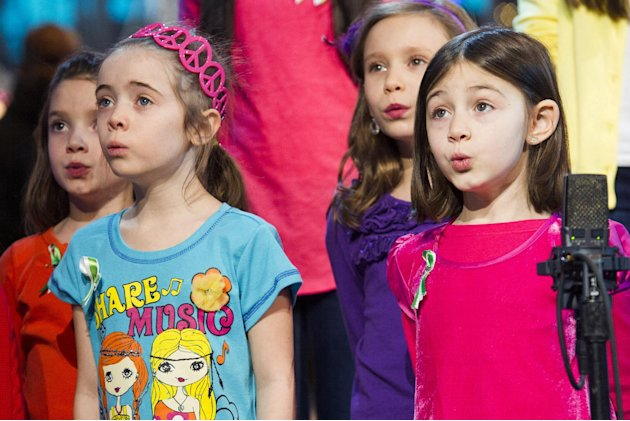 "Children from Newtown, Conn. and Sandy Hook Elementary school perform ""Somewhere Over the Rainbow"" on ABC's ""Good Morning America"" on Tuesday, Jan. 15, 2013 in New York. (Photo by Charles Sykes/Invisi"